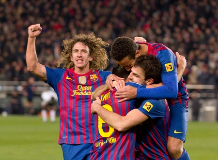 BARCELONA - FEBRUARY 2: Barcelona players celebrate a goal during the Spanish Cup match between FC Barcelona and Valencia, final score 2-0, on February 2, 2012, in Camp Nou stadium, Barcelona, Spain