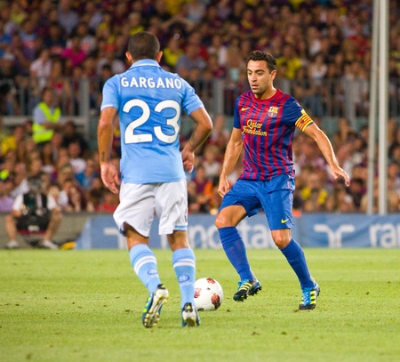 xavi: Xavi Hernandez in action during the Gamper Trophy final match between FC Barcelona and SSC Napoli, final score 5 - 0, on August 22, 2011 in Camp Nou stadium, Barcelona, Spain