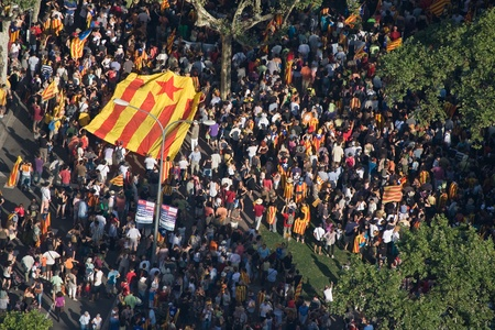 converge: BARCELONA, SPAIN - JULY 10: Up to a million people converge on Barcelona to join a rally demanding independence for Catalonia, on July 10, 2010, in Barcelona, Spain