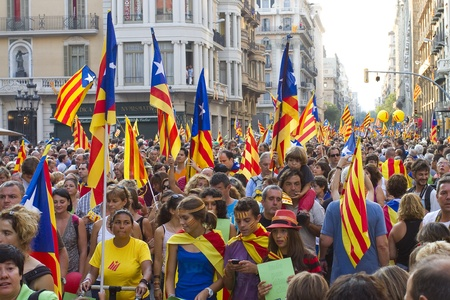 BARCELONA, SPAIN - SEPTEMBER 11: Up to a million people converge on Barcelona to join a rally demanding independence for Catalonia, on September 11, 2012, in Barcelona, Spain Stock Photo - 15156609