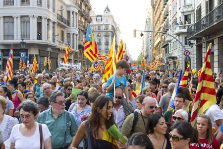 converge: BARCELONA, SPAIN - SEPTEMBER 11: Up to a million people converge on Barcelona to join a rally demanding independence for Catalonia, on September 11, 2012, in Barcelona, Spain