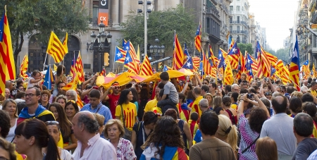 political rally: BARCELONA, SPAIN - SEPTEMBER 11: Up to a million people converge on Barcelona to join a rally demanding independence for Catalonia, on September 11, 2012, in Barcelona, Spain