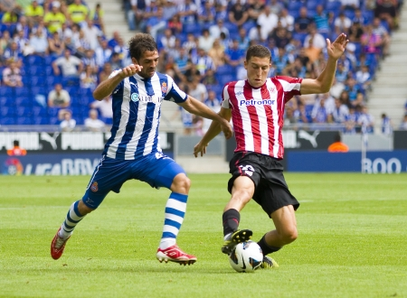 BARCELONA, SPAIN - SEPTEMBER 16: Victor Sanchez and Oscar De Marcos in action during the League match between Espanyol and Athletic, final score 3-3, on September 16, 2012, in Barcelona, Spain