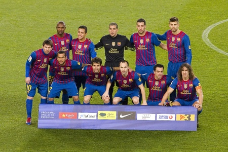 iniesta: BARCELONA - JANUARY 25: Barcelona players posing for photos before the Spanish Cup match between FC Barcelona and Real Madrid, final score 2 - 2, on January 25, 2012, in Camp Nou, Barcelona, Spain