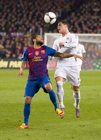 dani: BARCELONA - JANUARY 25: Dani Alves and Cristiano Ronaldo in action at the Spanish Cup match between FC Barcelona and Real Madrid, final score 2 - 2, on January 25, 2012, in Barcelona, Spain Editorial