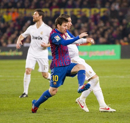 lionel: BARCELONA - JANUARY 25: Lionel Messi in action at the Spanish Cup match between FC Barcelona and Real Madrid, final score 2 - 2, on January 25, 2012, in Barcelona, Spain