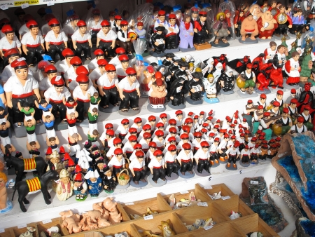 Some caganers, a character in Catalan mythology relating to a Christmas tradition in Catalonia, at the Santa Llucia Festival, on December 11, 2011, in Barcelona, Spain Stock Photo - 22193104