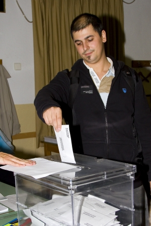 polling station: An unidentified man delivers his vote in a polling station during Spanish General Elections on November 20, 2011 in Barcelona, Spain Editorial
