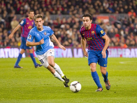 xavi: Xavi Hernandez of FCB in action during the Spanish Cup match between FC Barcelona and Osasuna, final score 4 - 0, on January 4, 2012 in Camp Nou stadium, Barcelona, Spain