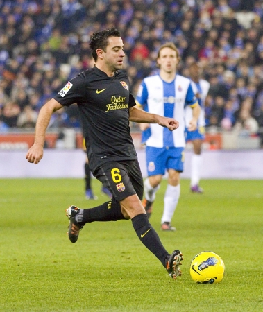 xavi: Xavi Hernandez of Barcelona in action during the Spanish league match between RCD Espanyol and FC Barcelona, final score 1-1, on January 8, 2012, in Barcelona, Spain Editorial