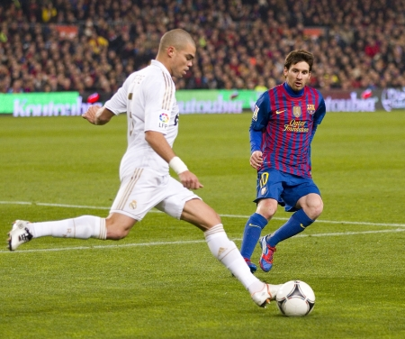 Pepe Laveran and Lionel Messi in action at the Spanish Cup match between FC Barcelona and Real Madrid, final score 2 - 2, on January 25, 2012, in Barcelona, Spain
