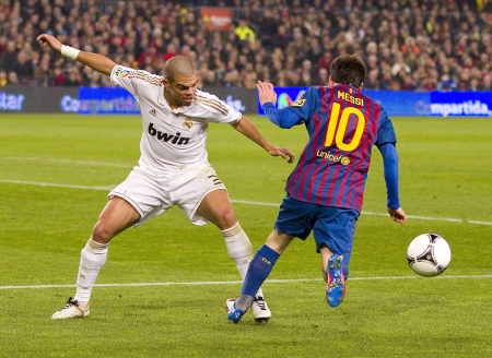 lionel: Pepe Laveran and Lionel Messi in action at the Spanish Cup match between FC Barcelona and Real Madrid, final score 2 - 2, on January 25, 2012, in Barcelona, Spain Editorial
