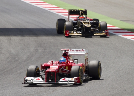 BARCELONA - MAY 13: Fernando Alonso of Ferrari F1 team racing at the race of Formula One Spanish Grand Prix at Catalunya circuit, on May 13, 2012 in Barcelona, Spain. The winner was Pastor Maldonado Editorial