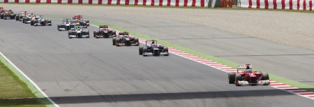 BARCELONA - MAY 13: Some cars racing at the race of Formula One Spanish Grand Prix at Catalunya circuit, on May 13, 2012 in Barcelona, Spain. The winner was Pastor Maldonado of Williams Renault team