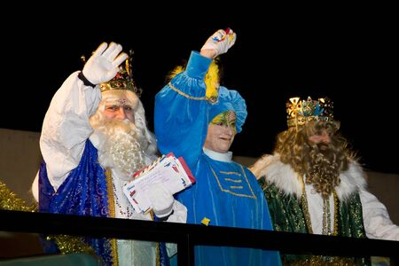 BARCELONA - JANUARY 5: Melchior and Gaspar Kings at the parade of the Biblical Magi Three Kings, who give toys to the children. Is a traditional spanish celebration. January 5, 2012 in Alella, Barcelona, Spain