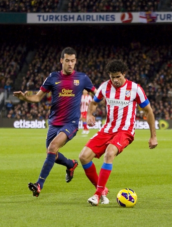 sergio: BARCELONA - DECEMBER 16: Sergio Busquets and Diego Costa at the Spanish League match between FC Barcelona and Atletico de Madrid, final score 4 - 1, on December 16, 2012, in Barcelona, Spain
