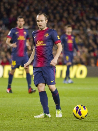 iniesta: BARCELONA - DECEMBER 16: Andres Iniesta in action at the Spanish League match between FC Barcelona and Atletico de Madrid, final score 4 - 1, on December 16, 2012, in Camp Nou, Barcelona, Spain