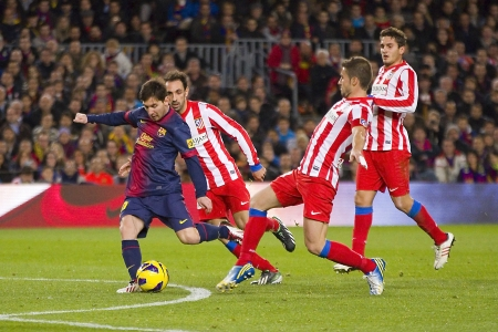 BARCELONA - DECEMBER 16: Lionel Messi in action at the Spanish League match between FC Barcelona and Atletico de Madrid, final score 4 - 1, on December 16, 2012, in Camp Nou, Barcelona, Spain Editorial