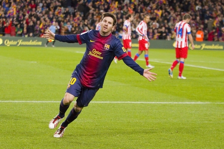 BARCELONA - DECEMBER 16: Lionel Messi celebrating a goal at the Spanish League match between FC Barcelona and Atletico de Madrid, final score 4 - 1, on December 16, 2012, in Camp Nou, Barcelona, Spain Stock Photo - 17327200