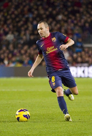 BARCELONA - DECEMBER 16: Andres Iniesta in action at the Spanish League match between FC Barcelona and Atletico de Madrid, final score 4 - 1, on December 16, 2012, in Camp Nou, Barcelona, Spain