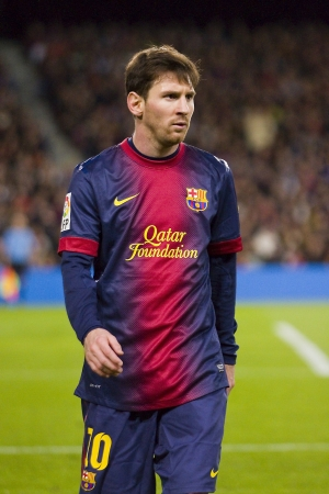 BARCELONA - DECEMBER 16: Lionel Messi in action at the Spanish League match between FC Barcelona and Atletico de Madrid, final score 4 - 1, on December 16, 2012, in Camp Nou, Barcelona, Spain