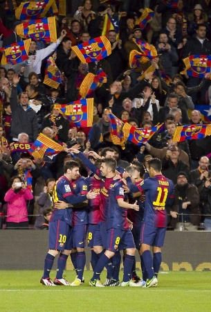 BARCELONA - DECEMBER 16: Players celebrating a goal at the Spanish League match between FC Barcelona and Atletico de Madrid, final score 4 - 1, on December 16, 2012, in Camp Nou, Barcelona, Spain