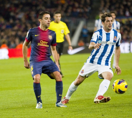xavi: BARCELONA - JANUARY 6: Xavi Hernandez of FCB in action during the Spanish League match between FC Barcelona and RCD Espanyol, final score 4 - 0, on January 6, 2013, in Barcelona, Spain