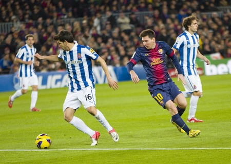 lionel: BARCELONA - JANUARY 6: Lionel Messi of FCB in action during the Spanish League match between FC Barcelona and RCD Espanyol, final score 4 - 0, on January 6, 2013, in Barcelona, Spain