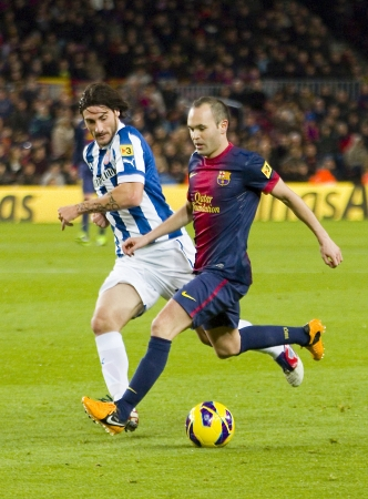 iniesta: BARCELONA - JANUARY 6: Andres Iniesta of FCB in action during the Spanish League match between FC Barcelona and RCD Espanyol, final score 4 - 0, on January 6, 2013, in Barcelona, Spain