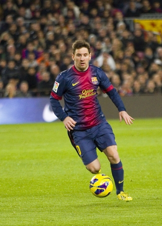 BARCELONA - JANUARY 6: Lionel Messi of FCB in action during the Spanish League match between FC Barcelona and RCD Espanyol, final score 4 - 0, on January 6, 2013, in Barcelona, Spain