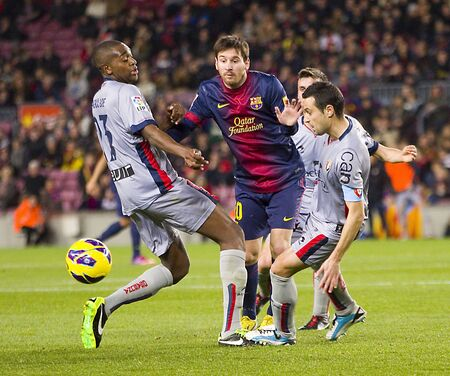 lionel: BARCELONA - JANUARY 27: Lionel Messi of FCB in action during the Spanish League match between FC Barcelona and Osasuna, final score 5 - 1, on January 27, 2013, in Barcelona, Spain Editorial
