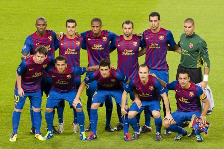 iniesta: BARCELONA - SEPTEMBER 13: Barcelona players at the Champions League match between FC Barcelona and AC Milan, 2 - 2, on September 13, 2011, in Camp Nou, Barcelona, Spain