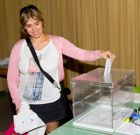polling station: BARCELONA, SPAIN -  An unidentified woman delivers her vote in a polling station during Spanish General Elections   in Barcelona, Spain Editorial