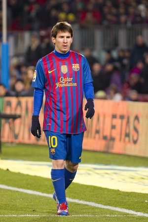 lionel messi: BARCELONA -   Lionel Messi in action during the Spanish Cup match between FC Barcelona and Valencia CF, final score 2-0,  in Camp Nou stadium, Barcelona, Spain Editorial