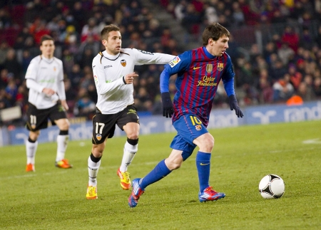 BARCELONA -   Lionel Messi in action during the Spanish Cup match between FC Barcelona and Valencia CF, final score 2-0,   in Camp Nou stadium, Barcelona, Spain Stock Photo - 18280066