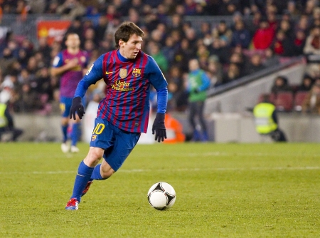 BARCELONA -   Lionel Messi in action during the Spanish Cup match between FC Barcelona and Valencia CF, final score 2-0,  in Camp Nou stadium, Barcelona, Spain Editorial