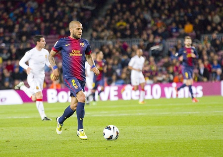 dani: BARCELONA - APRIL 6: Dani Alves in action at Spanish league match between FC Barcelona and RDC Mallorca, final score 5-0, on April 6, 2013, in Barcelona, Spain Editorial