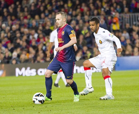 iniesta: BARCELONA - APRIL 6: Andres Iniesta in action at Spanish league match between FC Barcelona and RDC Mallorca, final score 5-0, on April 6, 2013, in Barcelona, Spain Editorial