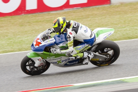 cip: Roberto Rolfo of Technomag CIP team compete at the race of Moto 2 Grand Prix of Catalunya, on June 3, 2012 in Barcelona, Spain. The winner was Andrea Iannone