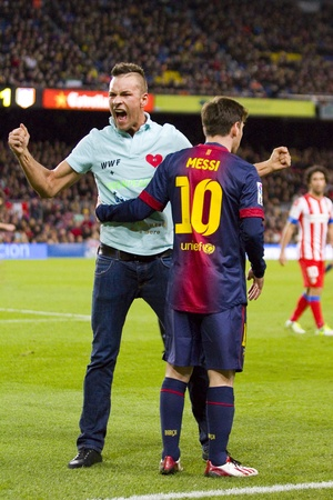 Spontaneous supporter and Lionel Messi at the Spanish League match between FC Barcelona and Atletico de Madrid, final score 4 - 1, on December 16, 2012, in Barcelona, Spain