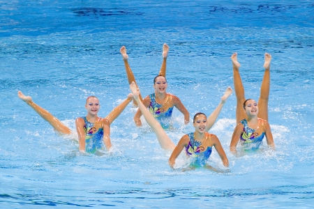 Kazakh team performs at Synchronized swimming Free Routine Final of 15th FINA World Championships, on July 26, 2013, in Barcelona, Spain  Russia wins the gold medal Imagens - 24706736
