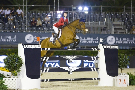 horse jumping: Reed Kessler from USA jumps a horse jumping obstacle during Longines Cup of the City of Barcelona, on September 27, 2013  The winner was Patrice Delaveau from France, riding the horse Carinjo Hdc