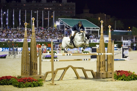 horse jumping: Rodrigo Diaz from Colombia jumps a horse jumping obstacle during Longines Cup of the City of Barcelona, on September 27, 2013  The winner was Patrice Delaveau from France, riding the horse Carinjo Hdc
