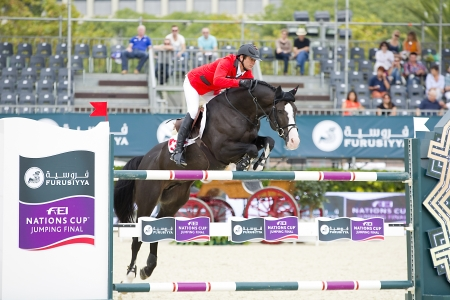 horse jumping: Beat Mandli from Switzerland jumps a horse jumping obstacle during Furusiyya FEI Nations Cup - Team Consolation Competition in Barcelona, on September 28, 2013  The winner was USA team Redactioneel