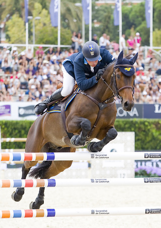 snob: Jens Fredricson from Sweden jumps a horse jumping obstacle during Furusiyya FEI Nations Cup - Team Consolation Competition in Barcelona, on September 28, 2013  The winner was USA team