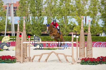 horse jumping: Lucy Davis from USA jumps a horse jumping obstacle during Furusiyya FEI Nations Cup - Team Consolation Competition in Barcelona, on September 28, 2013  The winner was USA team Editorial