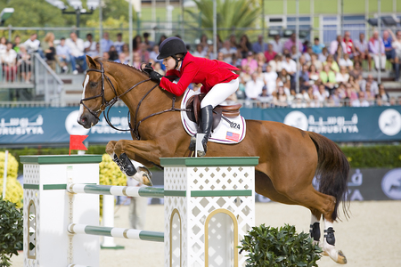 horse jumping: Steve Guerdat from Switzerland jumps a horse jumping obstacle during Furusiyya FEI Nations Cup - Team Consolation Competition in Barcelona, on September 28, 2013  The winner was USA team Editorial