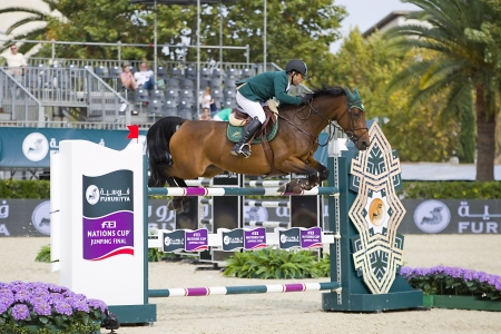 horse jumping: Kamal Bahamdan from Saudi Arabia jumps a horse jumping obstacle during Furusiyya FEI Nations Cup - Team Consolation Competition in Barcelona, on September 28, 2013  The winner was USA team Editorial