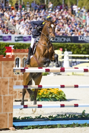 horse jumping: Cassio Rivetti from Ukraine jumps a horse jumping obstacle at CSIO - Furusiyya Nations Cup Horse Jumping Final Competition, on September 29, 2013, in Barcelona, Spain