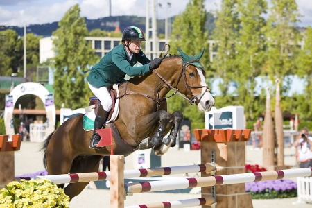 horse jumping: Cameron Hanley from Ireland jumps a horse jumping obstacle at CSIO - Furusiyya Nations Cup Horse Jumping Final Competition, on September 29, 2013, in Barcelona, Spain Editorial